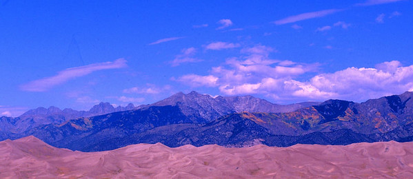 This photograph was taken west of the Great Sand Dunes National Park with the sand dunes in the foreground and the Sangre de Christi Mountains behind them.