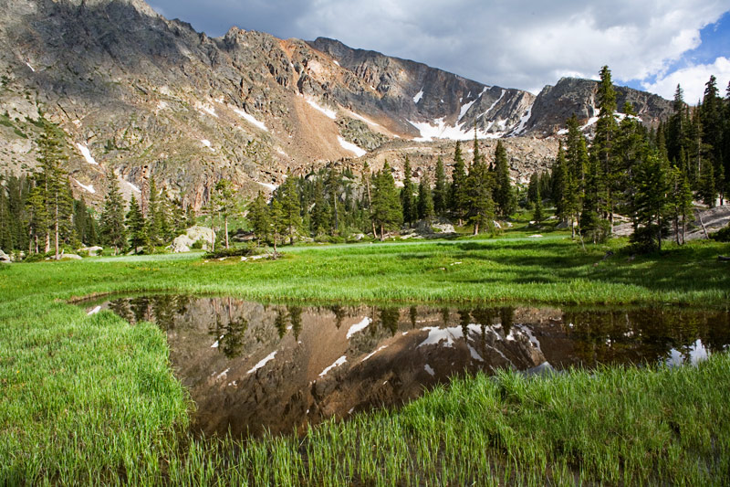 Reflections on a small pond below Columbine Lake