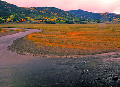 The Rio Grande River winds through pastures of Mineral County, Colorado.