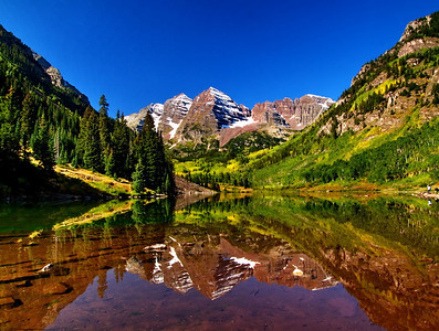 Maroon Bells peaks taken September 15, 2008.  Equipment: Leica Digilux 3, Singh-Ray Polarizing/Warming filter, Slick carbon fiber tripod with Slick ball head. One of the most beautiful places on earth!
