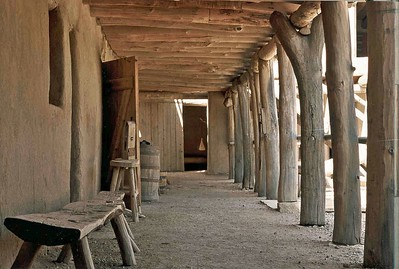 """""""Open Door"""" was photographed at Bent's Fort in Colorado, near La Junta, CO.  Your eye is drawn down the covered walkway to the open door.  Bent's Fort was built in the 1830's by the Bent brothers for the western fur trade.  It was an important stop on the Old Spanish Trail to Sante Fe."""