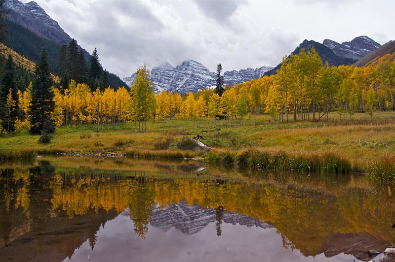 The Maroon Bells autumn pond reflection; Colorado Elk Range.