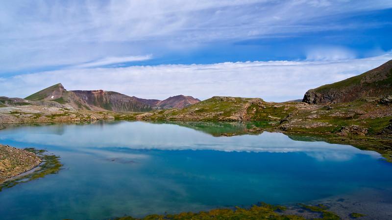A serene setting, the high Sloan Lake (12,920 ft.) at the upper American Basin below Handies Peak; Colorado San Juan Range.
