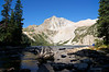 Backpackers enjoy the serenity of a late summer morning at Snowmass Lake; Colorado Elk Range
