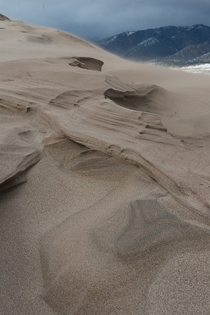 The frozen sand was sculpted into unusual shapes by the wind.