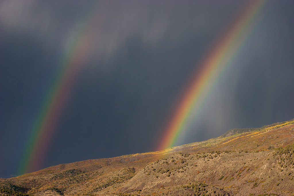 (WC-08130)  Double rainbow over the valley of the Roaring Fork River.