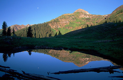 (E007)  Early evening reflection in lower Porphyry Gulch.