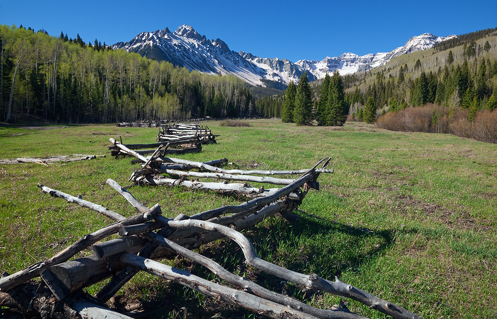 (SN-10003)  Rail fence beneath Mount Sneffels.