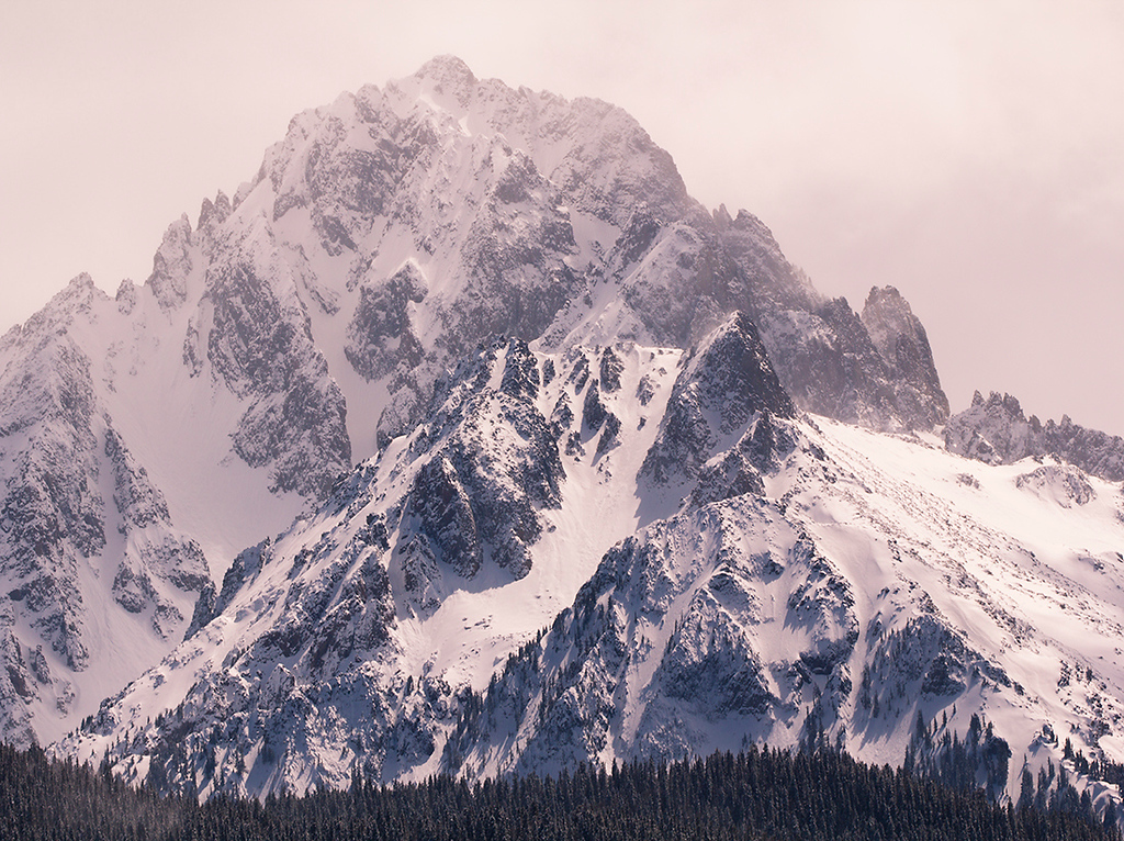 (SJ-11067)  North face of 14,150' Mount Sneffels revealed through clearing winter storm.