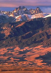 (I008)  Crestone Peak & Needle rise above Great Sand Dunes at sunset