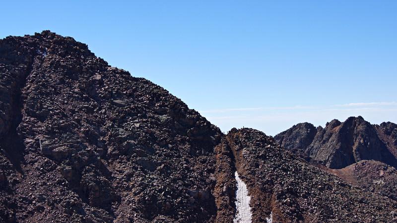 Climbers traversing a notch below Windom's summit; Colorado San Juans.