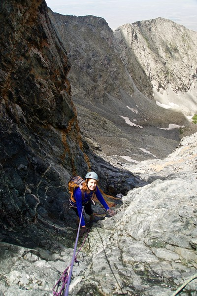 "A belayed downclimb of the treacherous ""hourglass"" gully just below the summit of Little Bear Peak; Colorado Sangre de Cristo Range"