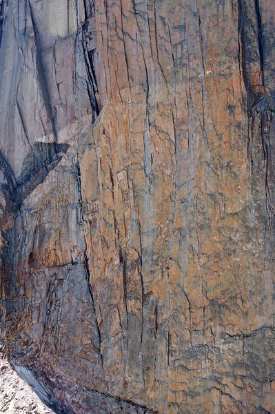 Two climbers take on a difficult pitch at the middle of the Diamond; Rocky Mountain National Park, Colorado.