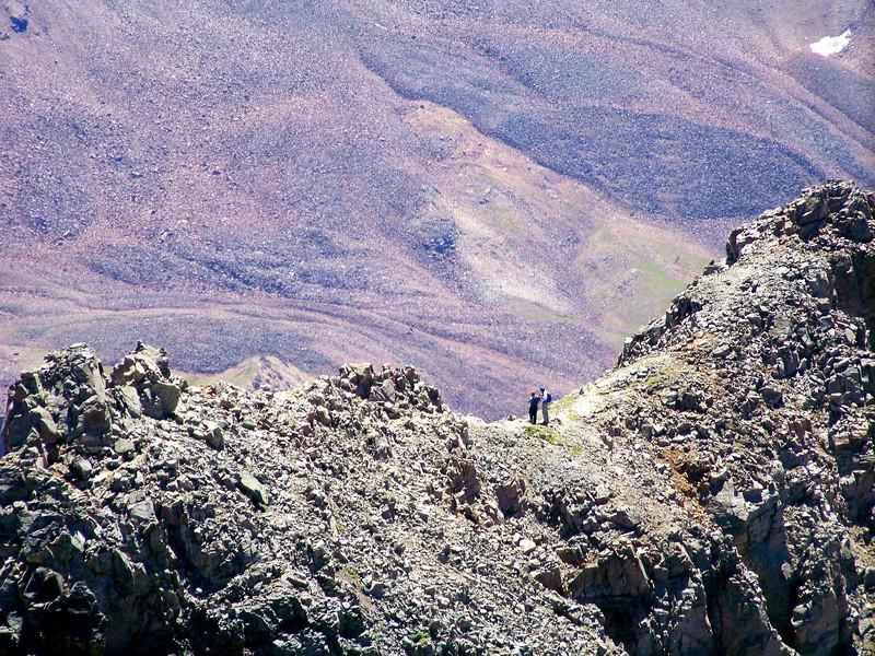 Hikers on the Maroon Peak south ridge survey the route down, Colorado Elk Range