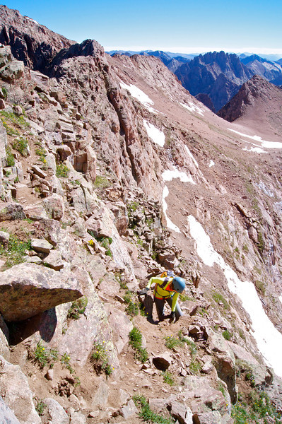 After crossing the Catwalk, the route drops down slightly, leading hikers to the steep 250 foot East Face of Mount Eolus; Colorado San Juan Range