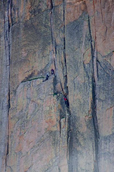 Climbers work their way up the Diamond; Rocky Mountain National Park, Colorado.
