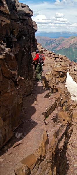 An easy, but VERY NARROW ledge below Pyramid Peak's northeast ridge; Colorado Elk Range.