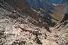 A steep climb at 13,500 ft. up the east gully on Crestone Needle's south face; Colorado Sangre de Cristo Range.