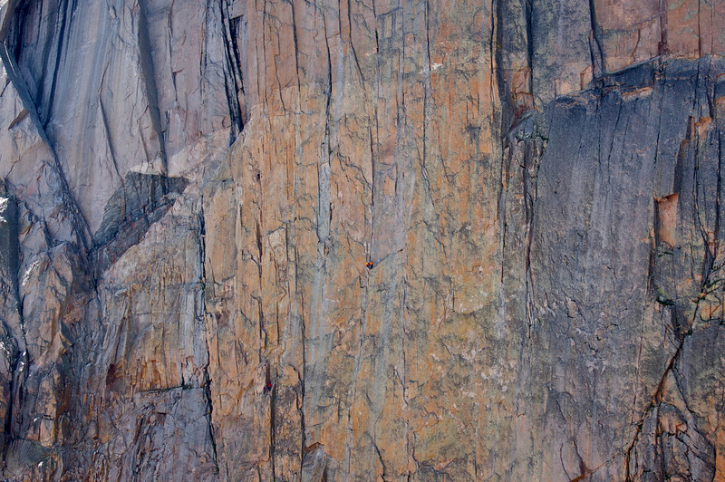A pair of climbers at the midpoint of the Diamond; Rocky Mountain National Park, Colorado.