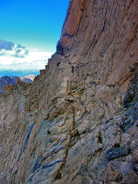"""Hikers hug the cliff wall on """"The Narrows.""""  Longs Peak trail, Rocky Mountain National Park"""