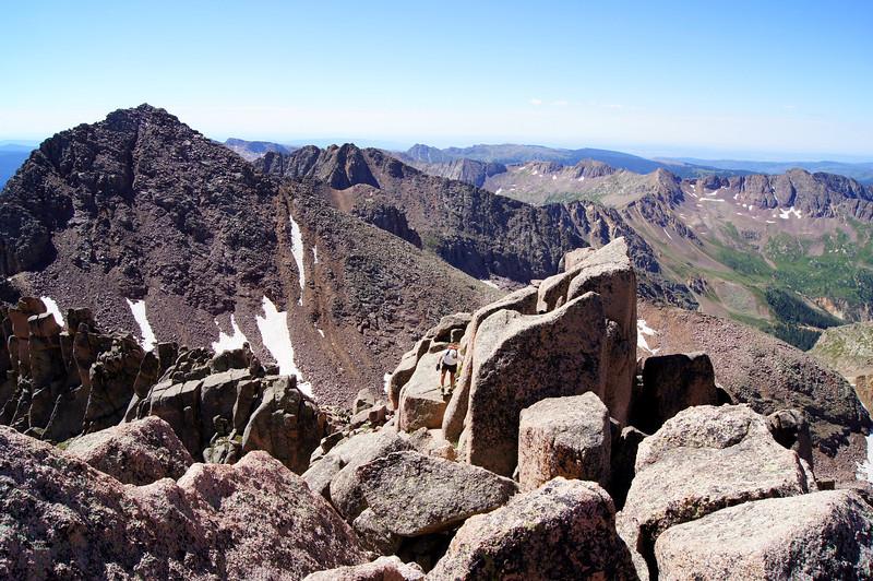 "Hiker ""Bulldog"" on the final approach to Sunlight's summit; Windom Peak in the background.  Colorado San Juans."
