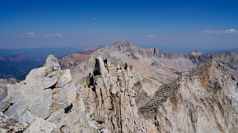 Climbers approach the Snowmass Mountain summit along the north ridge; Capitol Peak dominates the view to the north. Colorado Elk Range