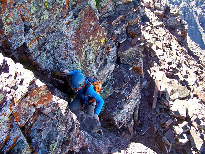 Free-climbing a steep chimney just below the Maroon Peak summit, Colorado Elk Range