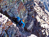 Free-climbing a steep chimney just below the Maroon Peak summit, Colorado Elk Range