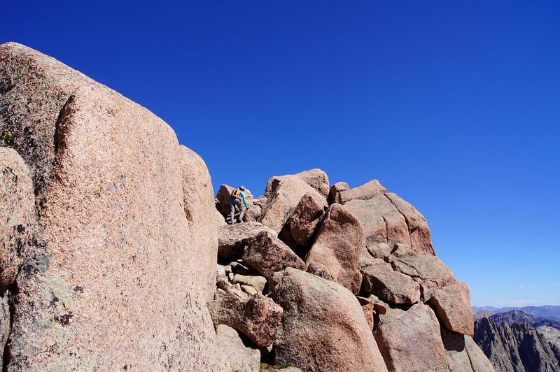 Traversing ledges to Sunlight's summit block; Colorado San Juans.