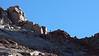 A hiker negotiates the southeast ridge of Sunlight Peak, Colorado San Juans.