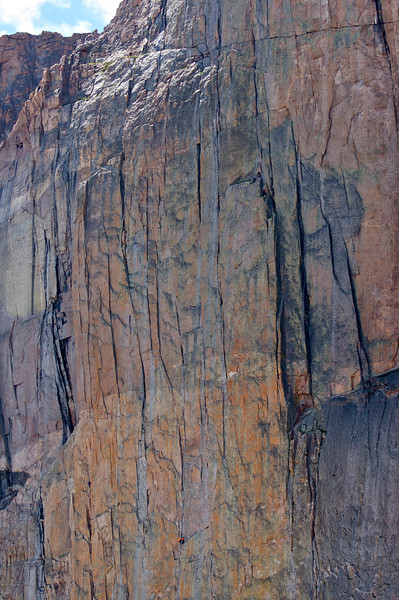 Two parties of climbers about halfway up the Diamond; Rocky Mountain National Park, Colorado.