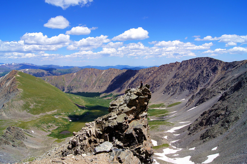 A hiker stands atop a lone pinnacle on Grays Peak's east side, Colorado Front Range.
