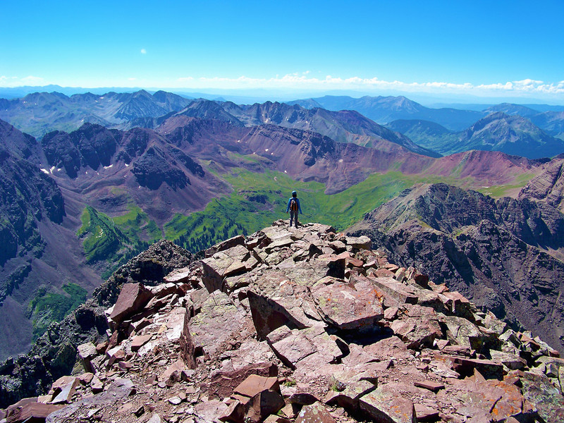 A climber begins the descent from the Maroon Peak summit, Colorado Elk Range