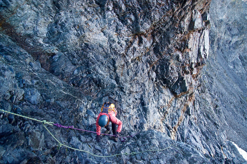 Climbing the steep, narrow and WET hourglass gully at 13,500 feet, just below the summit of Little Bear Peak.  The fixed ropes are in poor condition and provide only minimal security; Colorado Sangre de Cristo Range