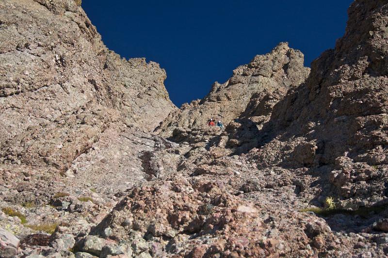 Climbers descending the lower east gully, 13,300 ft., on Crestone Needle's south face; Colorado Sangre de Cristo Range.