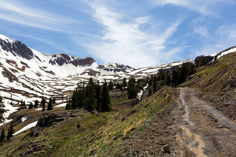 Heading up to Cinnamon Pass. The road is on the right side with a switchback about 1/2 way up the photo.