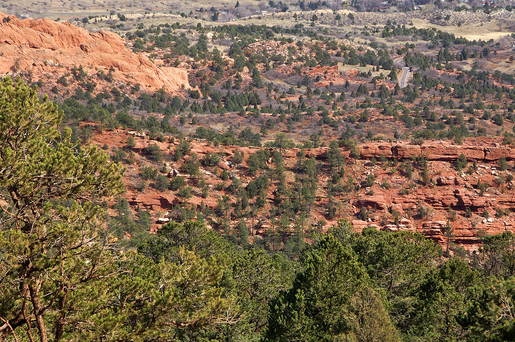 The view from Rampart Range Road above the pride of Colorado Springs, Garden of the Gods Park, in the distance is the park road.