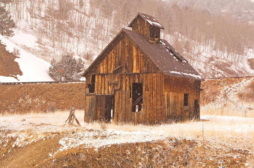 An abandoned school house in a winter squall near Cripple Creek, CO