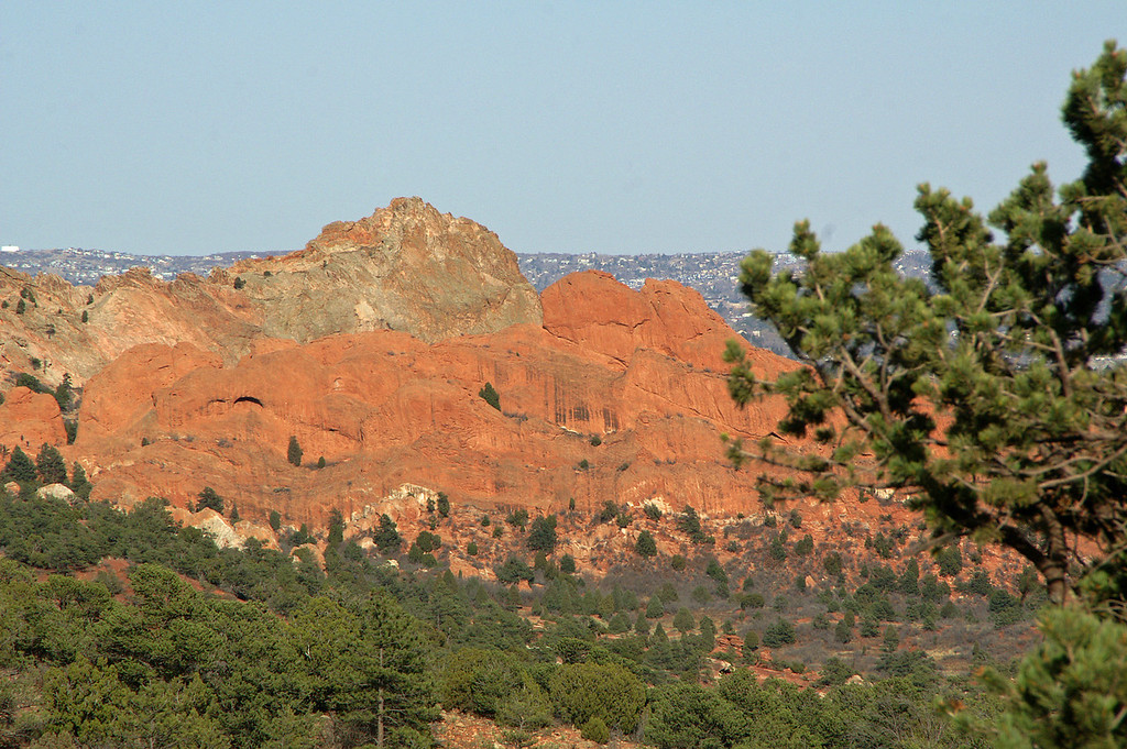 Garden of the Gods rock formations as seen from Rampart Range Road, Colorado Springs is in the distance.