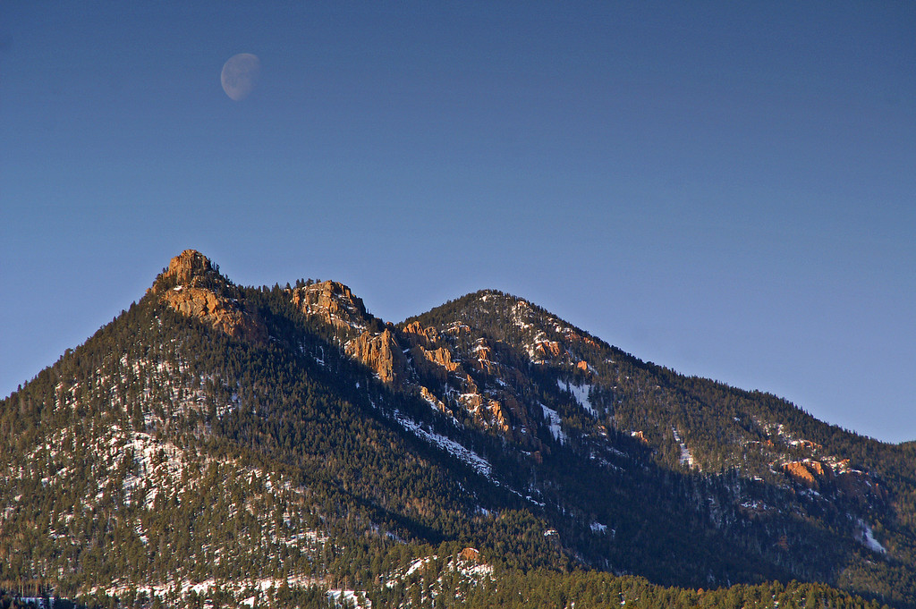 The moon sets over the front range of the Rockies