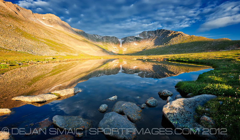 MT_EVANS-5285-8x14<br /> This image is a small lake feed by Summit lake further west abutting the peaks you see in the background.  I was following and shooting a stream as the sun began to rise.  When done, I followed the stream leading me to this beautiful pristine lake with the reflection of Mt Evans and adjoining ridges & saddles.  This image was a defining moment for the day...calming, crisp, drawing me into a world more visited my the local wildlife than man.