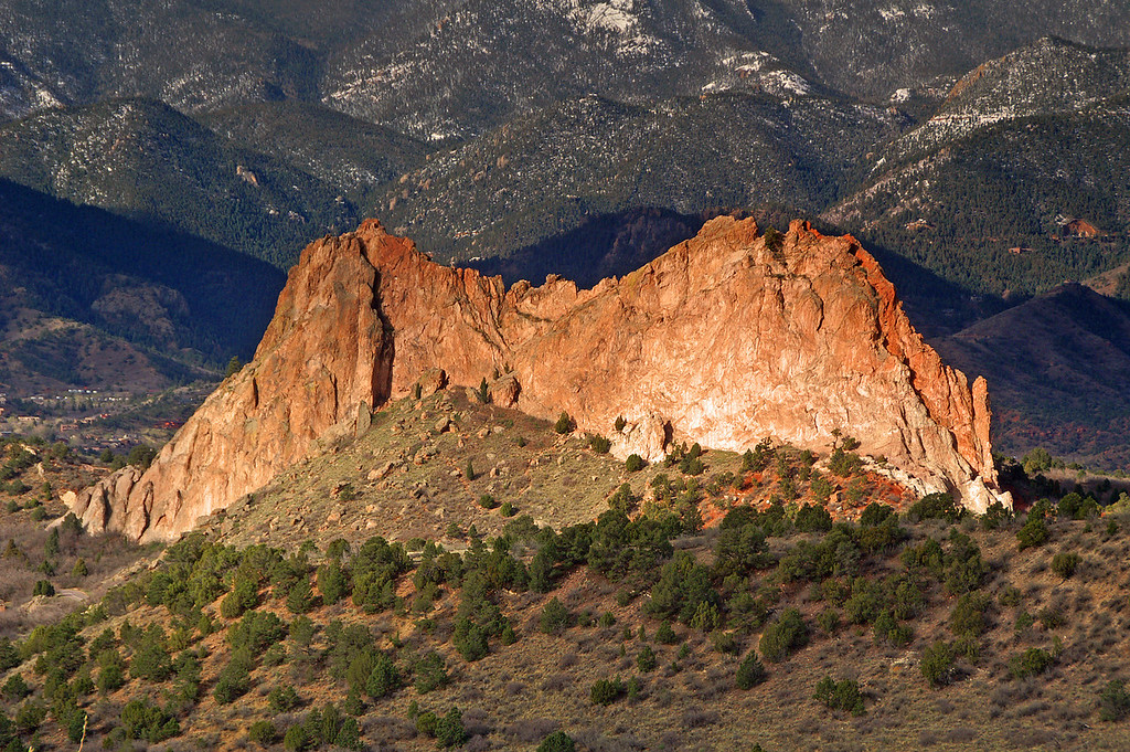 An early morning view of one of the unusual rock formations in Garden of the Gods Park. Behind is the start of the Colorado Rockies. Sharp eyed viewers will note the grade of the former Colorado Midland Railroad.