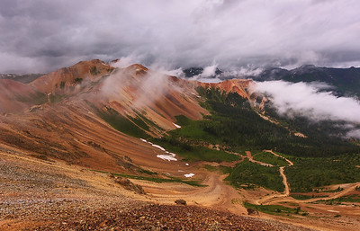 Red Mountan. The view of Red Mountain near Ouray, Colorado from the top of Corkscrew Trail soon became shrouded in clouds as summer afternoon rains passed through