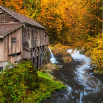"Autumn Glow at cedar creek Grist Mill<br /> <br /> Please checkout my FB page and like us here:  <a href=""http://www.facebook.com/MagicLightPhotography"">http://www.facebook.com/MagicLightPhotography</a><br /> <br /> This weekend i went to place i wanted to shoot for ~1 year. I've heard about it from couple of my friends and recommendations was to visit in Autumn... Last weekend was perfect opportunity for me to visit as i was driving down to Columbia river gorge for some fall color shooting. The leaves were past prime by a week. There were more leaves on ground than on the trees.<br /> <br /> The conditions were definitely not perfect and i decided to pack my bag and he<br /> ad back.. It rained suddenly and i decided to wait under covered bridge near this mill. Rain not only helped in saturating some colors but bring some fog.<br /> <br /> I decided to shoot again and grabbed couple of shots... Here is one of my favorite from the trip."