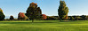 Panorama #1 (of 4):  Golf course in early autumn in early morning