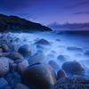 Beautiful blue twilight of the unique pebble beach of Porth Naven, Cornwall, England.