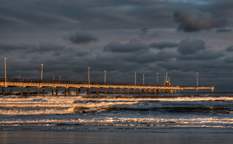 The last rays of sun shine on the Bob Hall pier in Corpus Christi, Texas