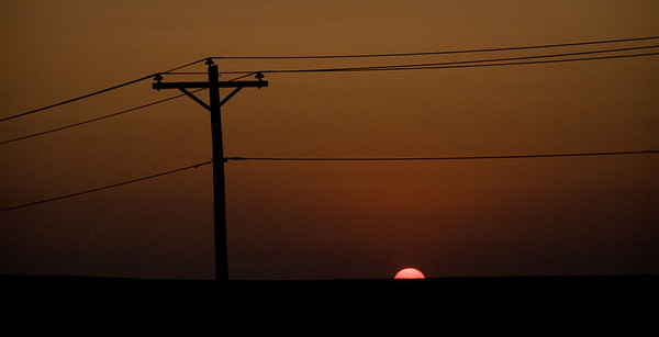 Telephone lines at sunset