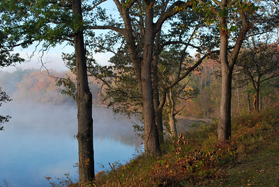 Fog lifting off of lake revealing a beautiful fall morning. Located at Deer Creek State Park in central Ohio.