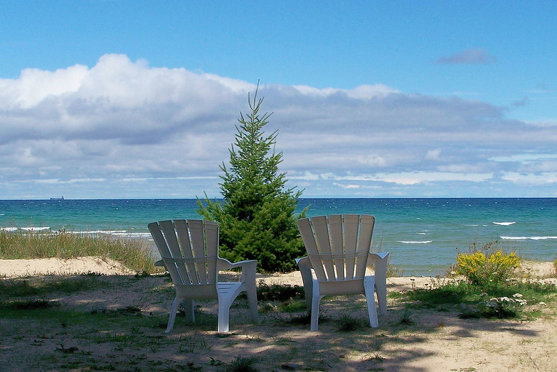 Adirondak chairs with a view of Lake Huron. Photo taken near the 40 Mile Point Light House in Michigan